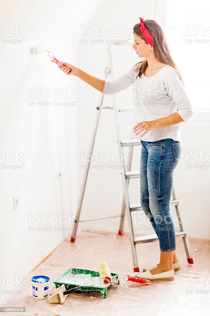 Young woman in home improvement works stock photo