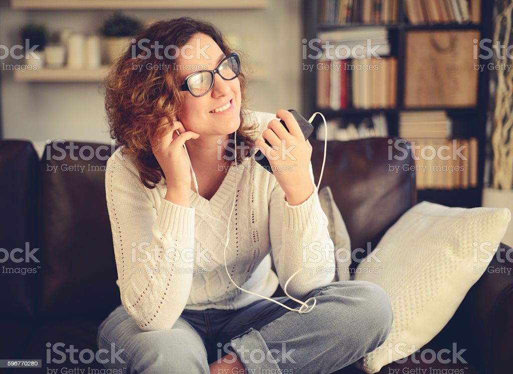 young woman in home interior stock photo