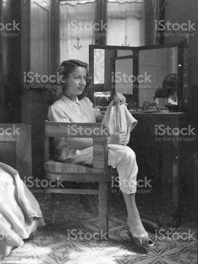 Young woman in hotel room from 1941 royalty-free stock photo