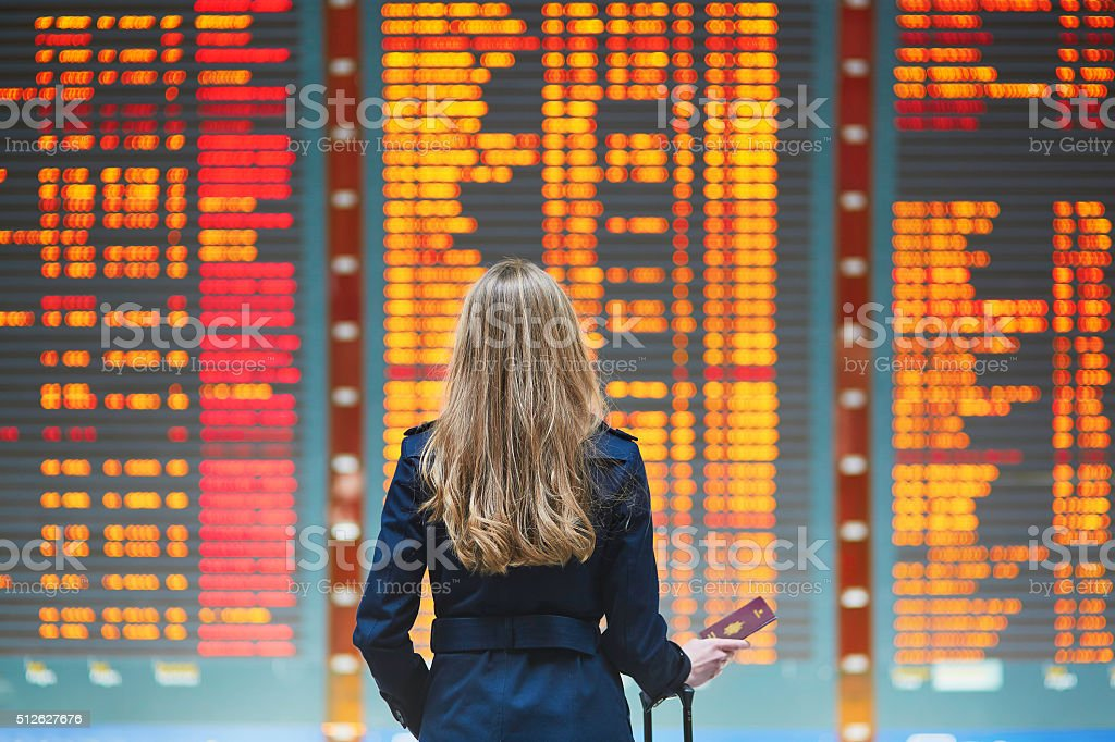 Young woman in international airport stock photo
