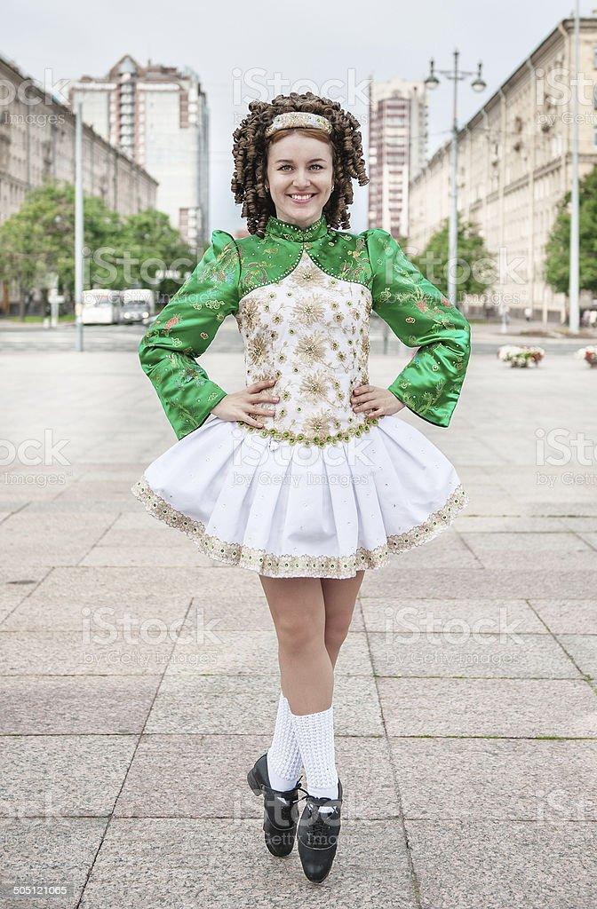 Young woman in irish dance dress posing stock photo