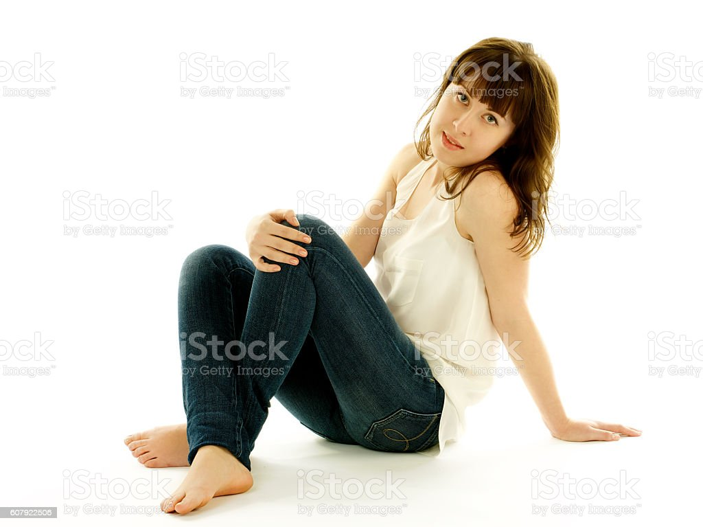 Young Woman in Jeans and Barefoot stock photo