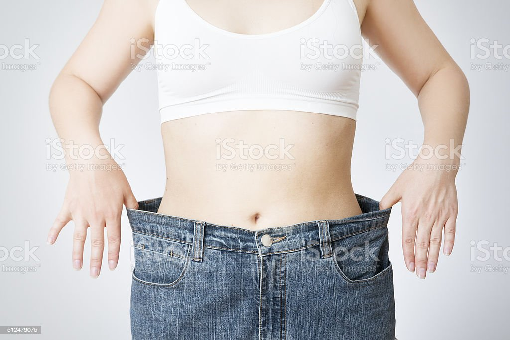 Young woman in jeans of large size stock photo