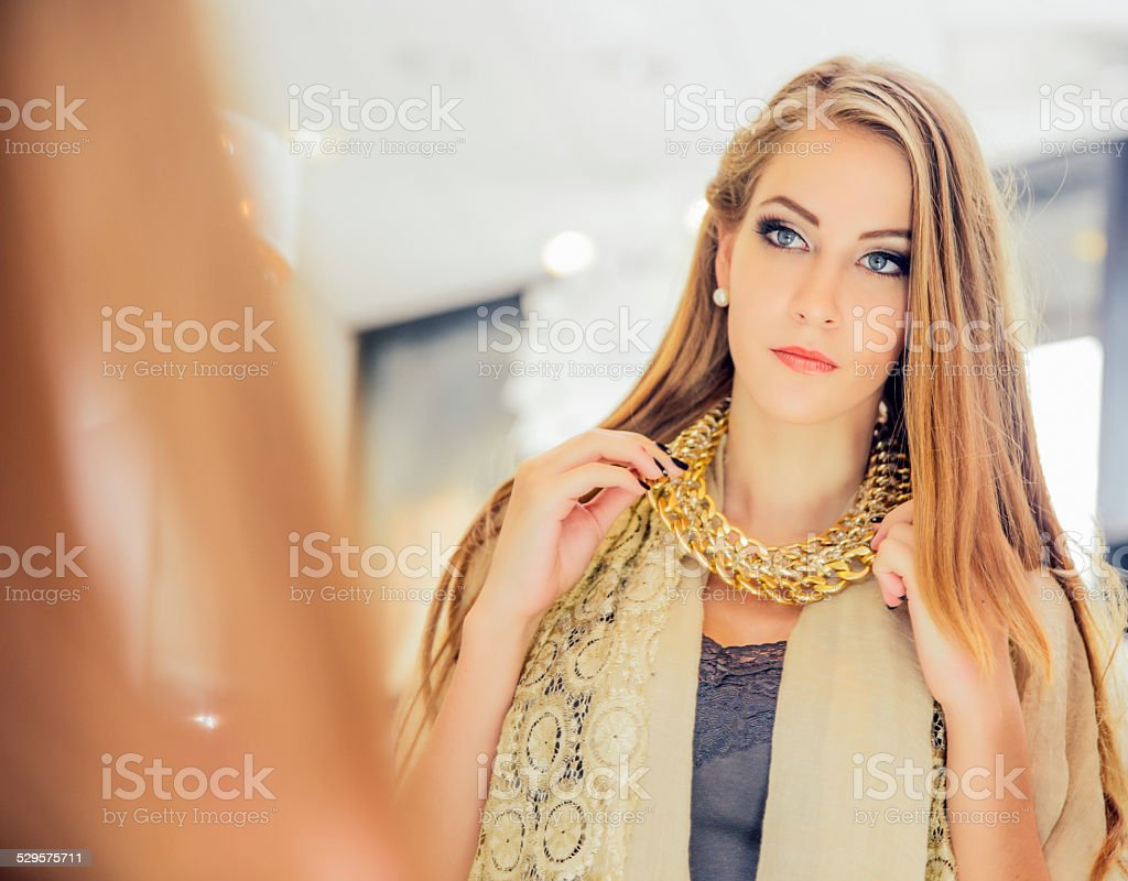 Young woman in jewelry shop stock photo