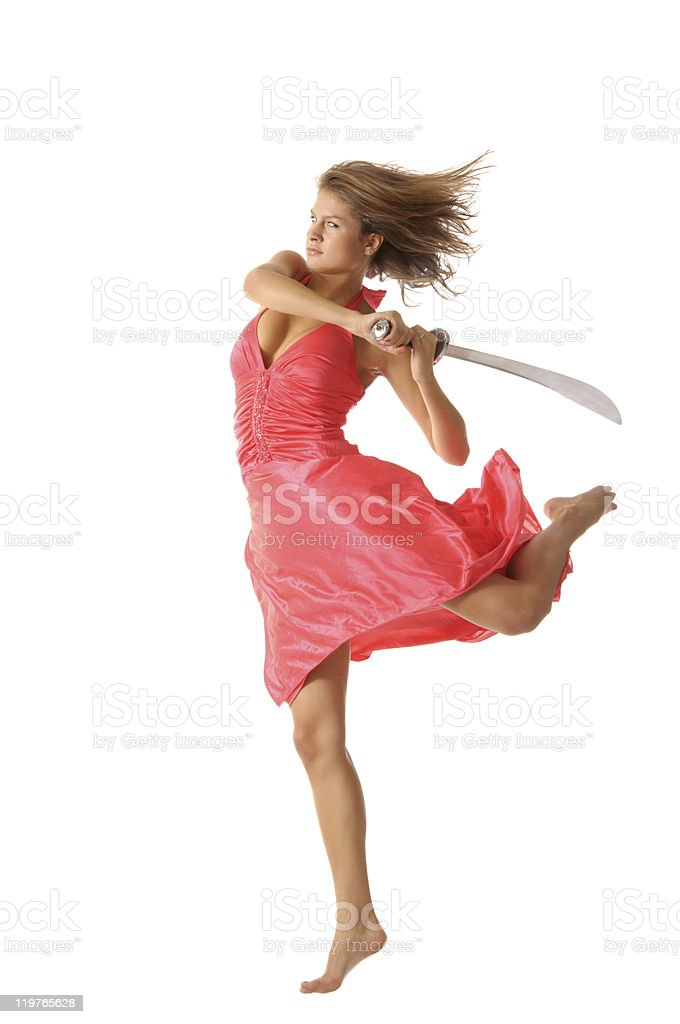 Young woman in jump with sword stock photo
