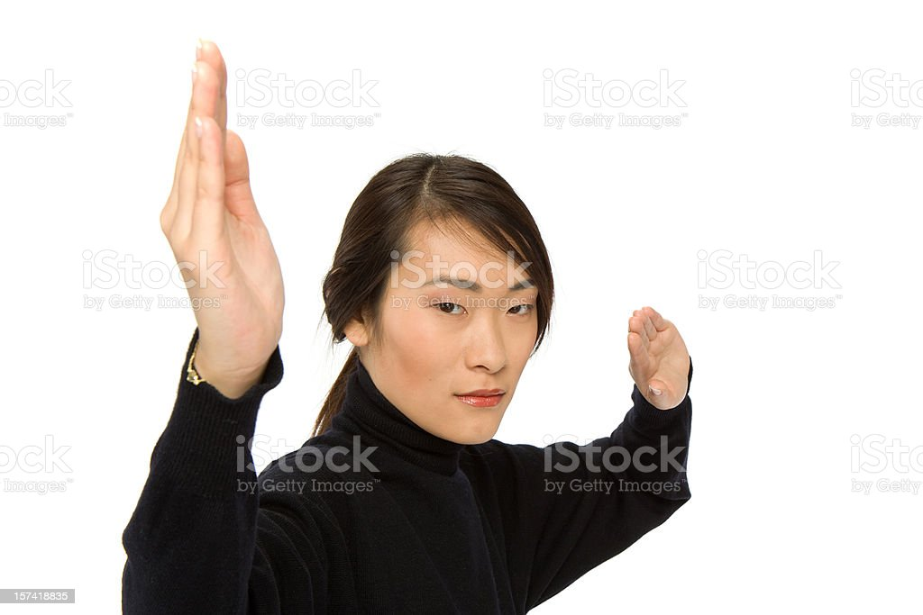 young woman in karate fighting pose royalty-free stock photo