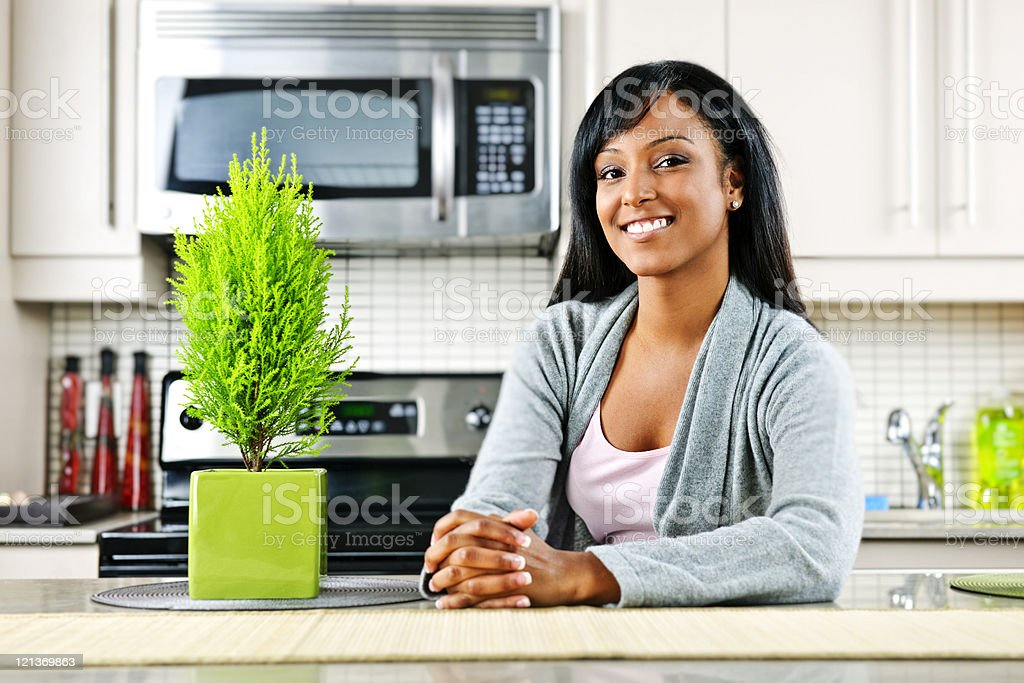 Young woman in kitchen royalty-free stock photo