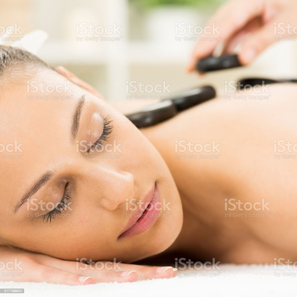 Young woman in lastone therapy stock photo