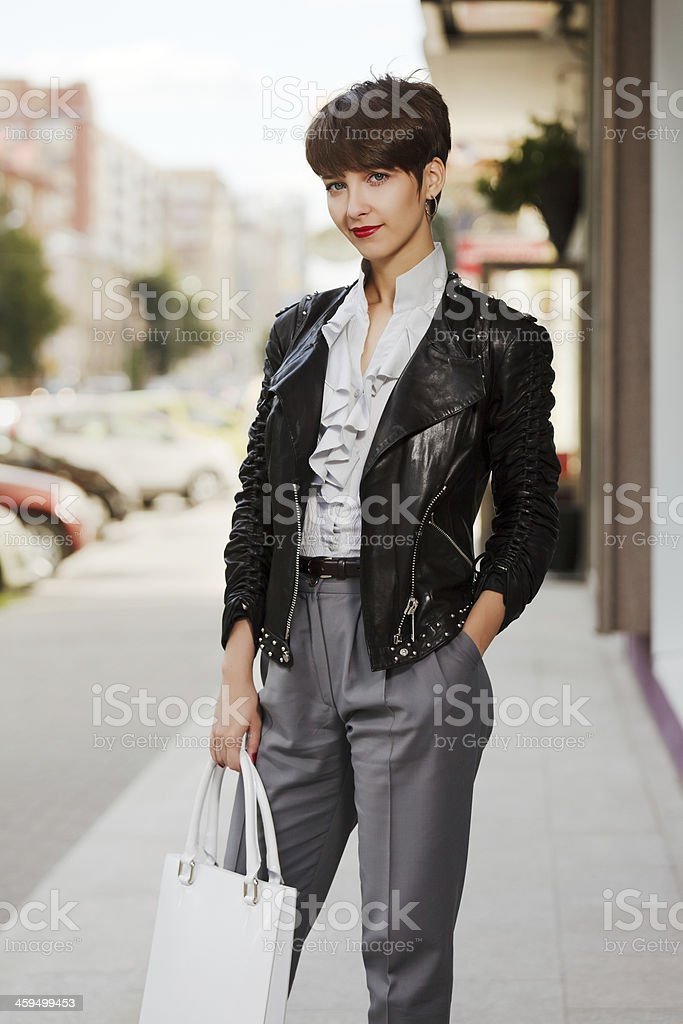 Young woman in leather jacket stock photo