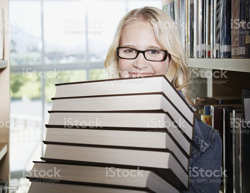 Young woman in library at school with books royalty-free stock photo