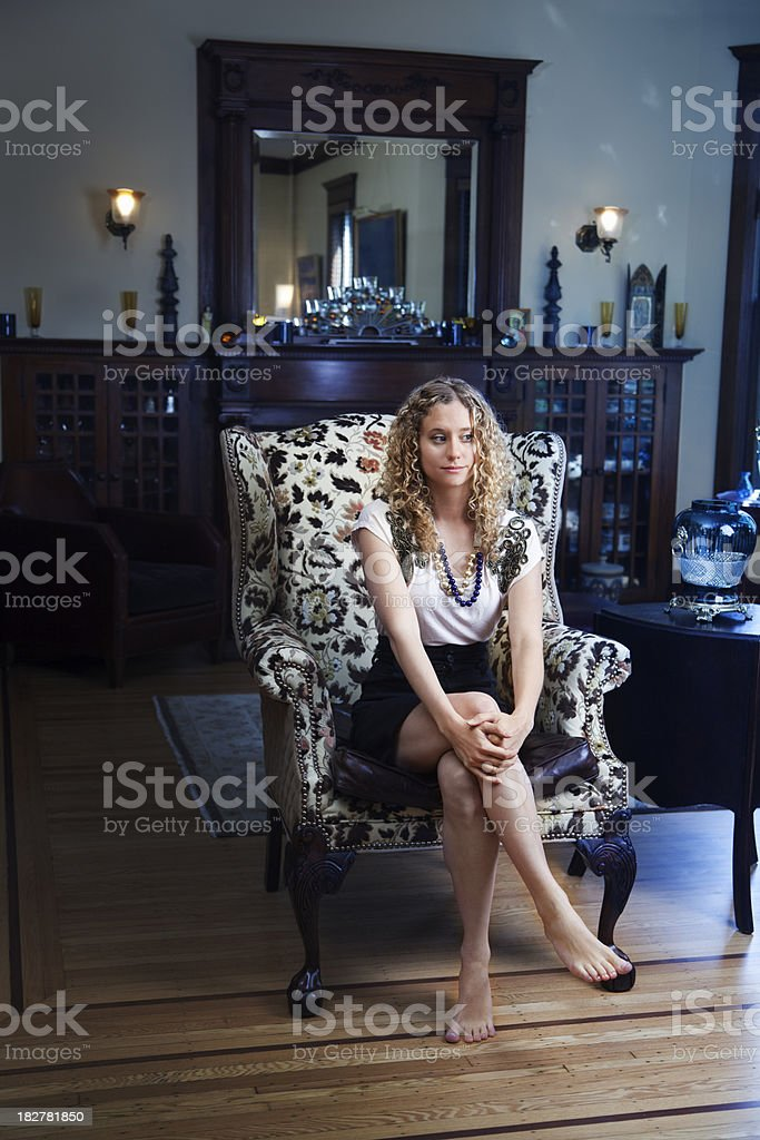 Young Woman in Living Room of Traditional Home Decor royalty-free stock photo