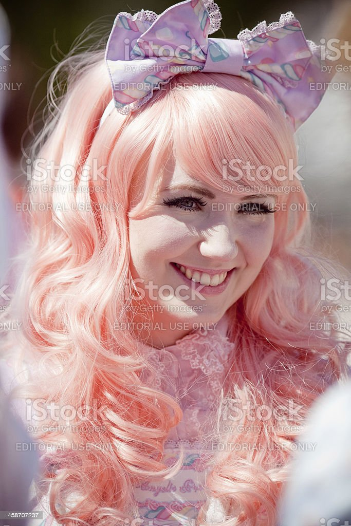 Lolita dressed young woman at UppCon stock photo