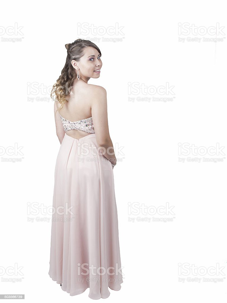 Young woman in long dress looking over her shoulder stock photo