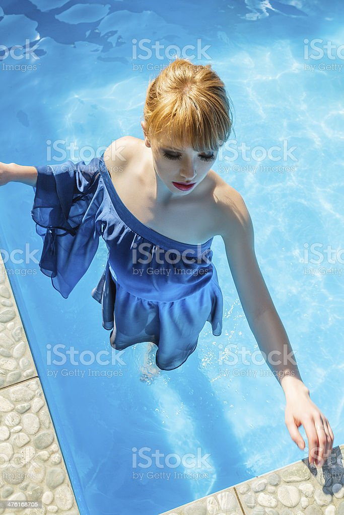 Young woman in luxurious blue dress royalty-free stock photo