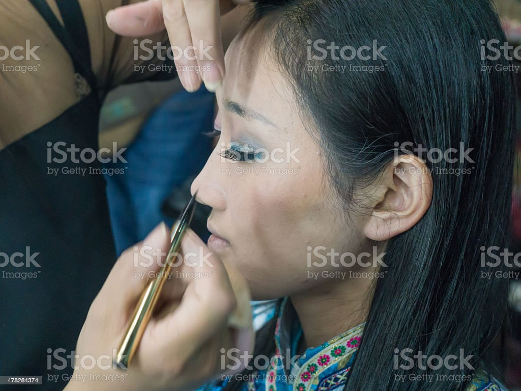 Young woman in makeup stock photo