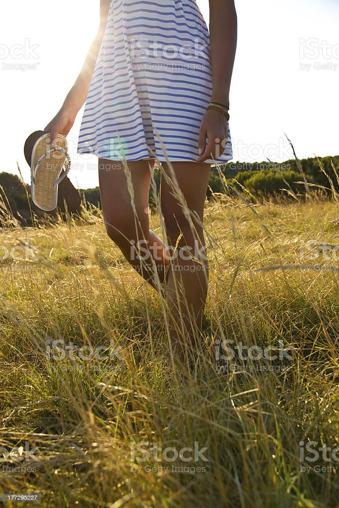 young woman in meadow stock photo