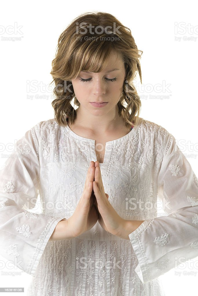 Young woman in meditative pose on a white background royalty-free stock photo