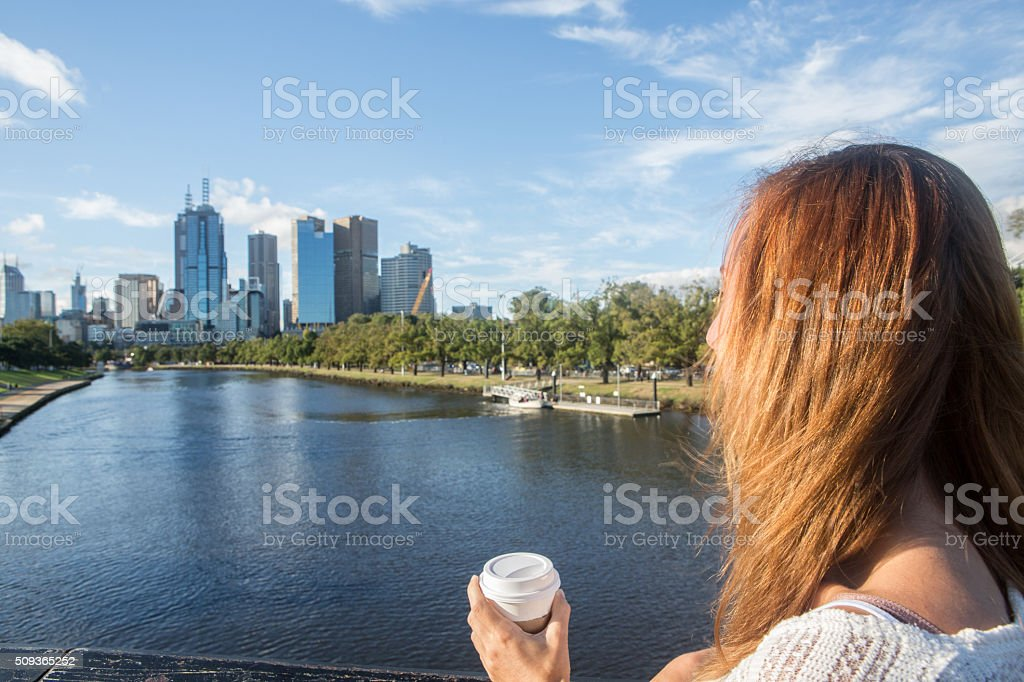 Young woman in Melbourne on bridge overlooks the Melbourne CBD stock photo