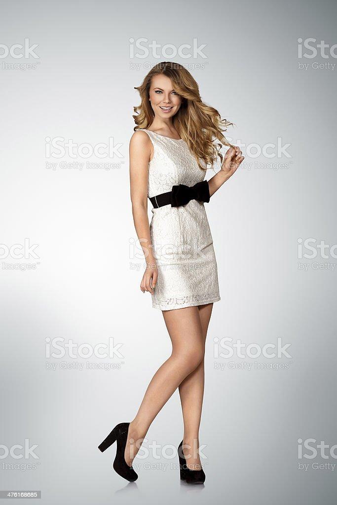 Young woman in mini dress stock photo