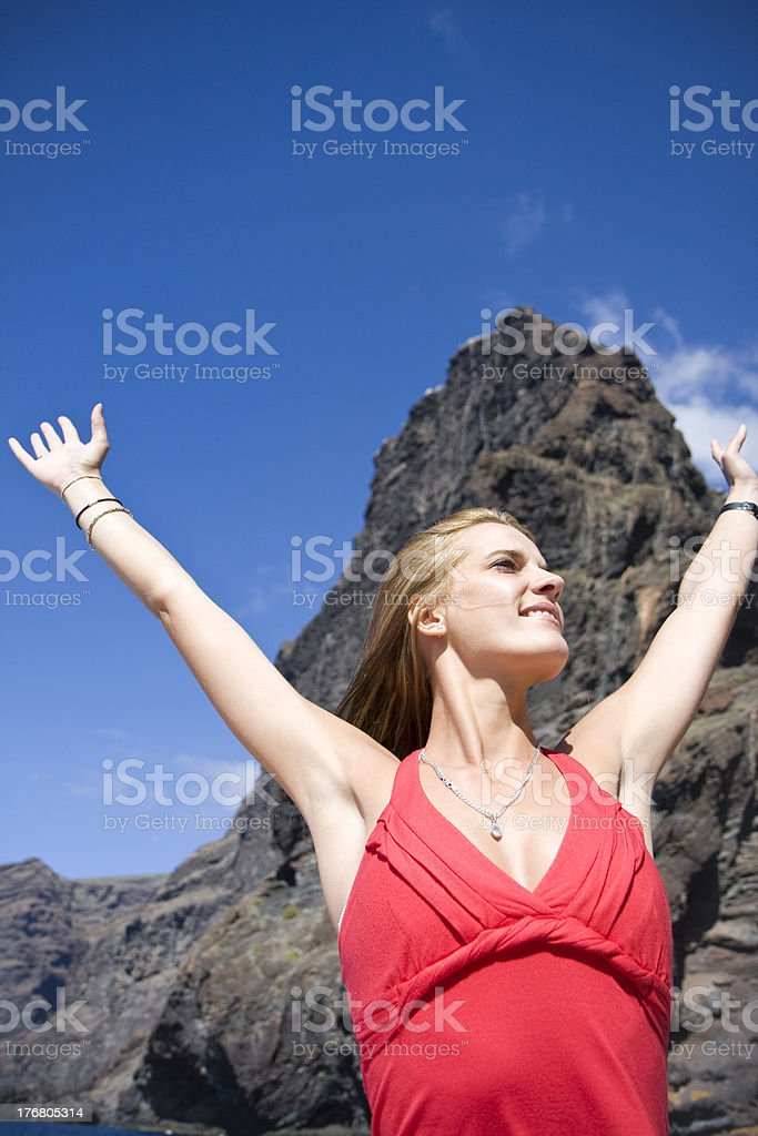 Young woman in mountains background stock photo