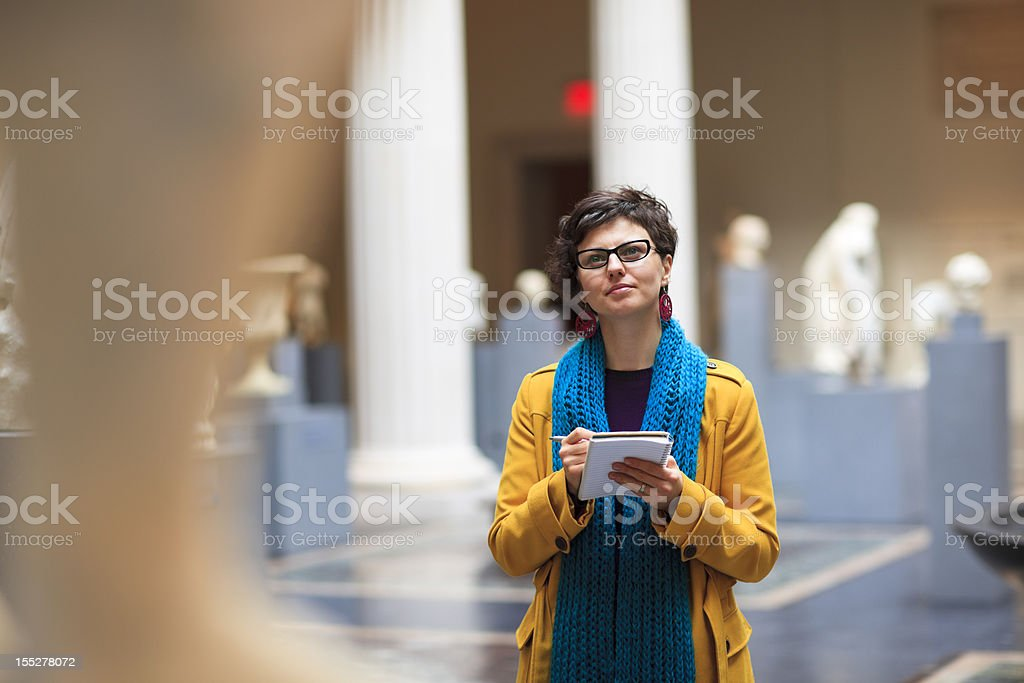 Young woman in museum stock photo