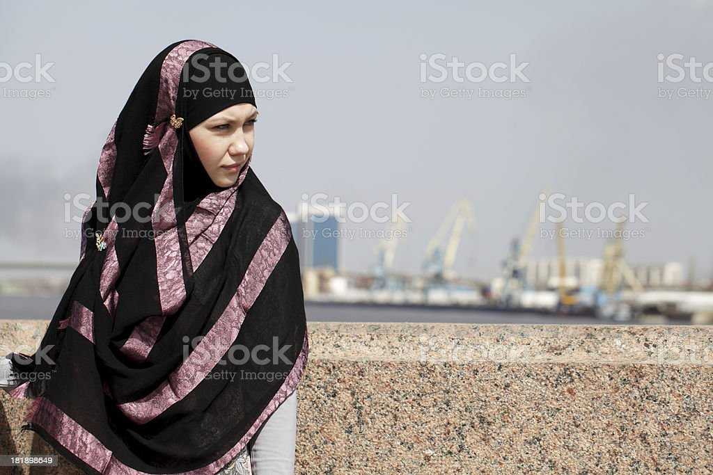 young woman in Muslim clothes stock photo