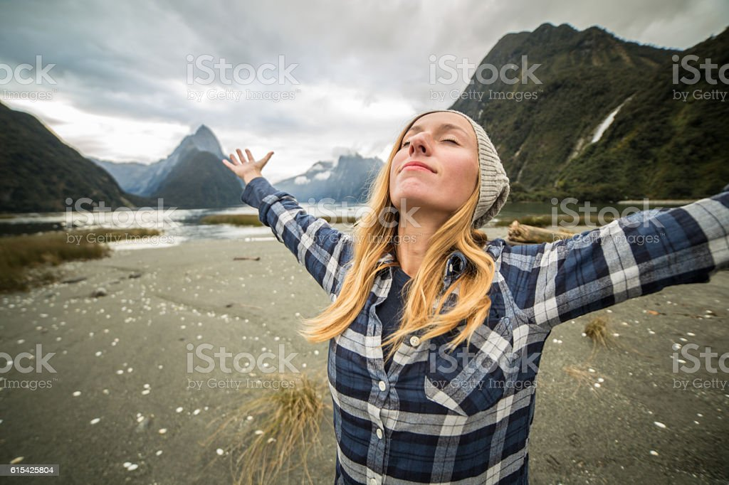 Young woman in nature streches body stock photo