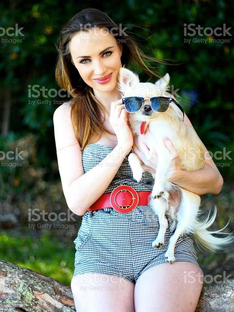 Young woman in nature with chihuahua stock photo
