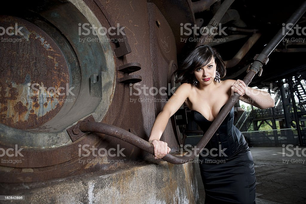 Young woman in old factory stock photo