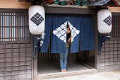 Young woman in old Japanese village