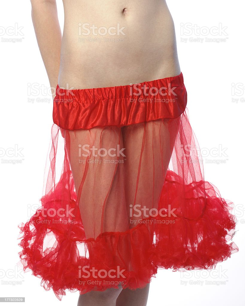 Young woman in only red crinoline close-up stock photo
