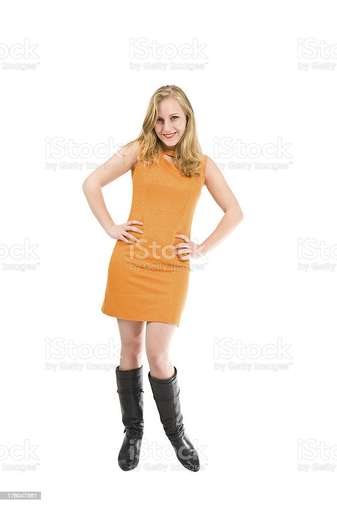 Young woman in orange dress stock photo