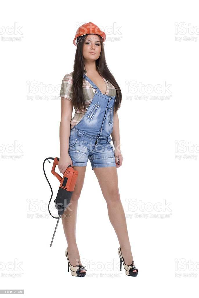 Young woman in orange helmet holding hammer drill royalty-free stock photo