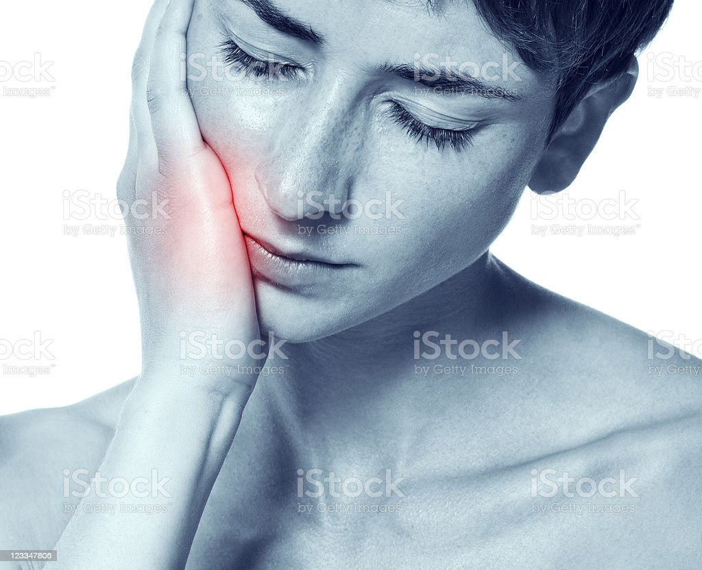 Young woman in pain is having toothache royalty-free stock photo