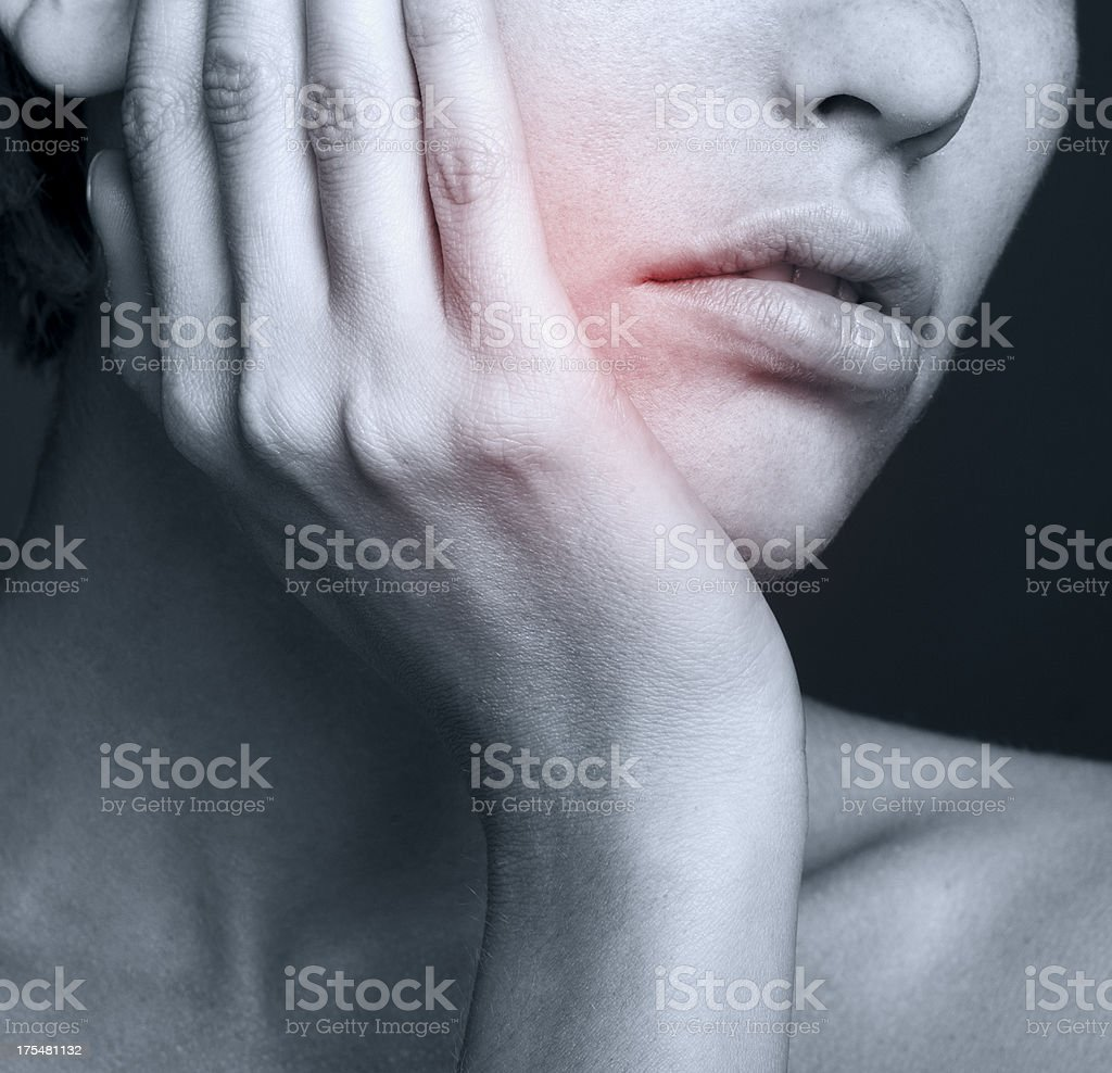 Young woman in pain is having toothache stock photo