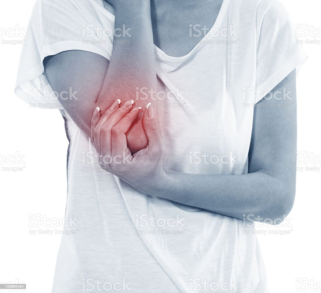 Young woman in pain with an elbow injury stock photo