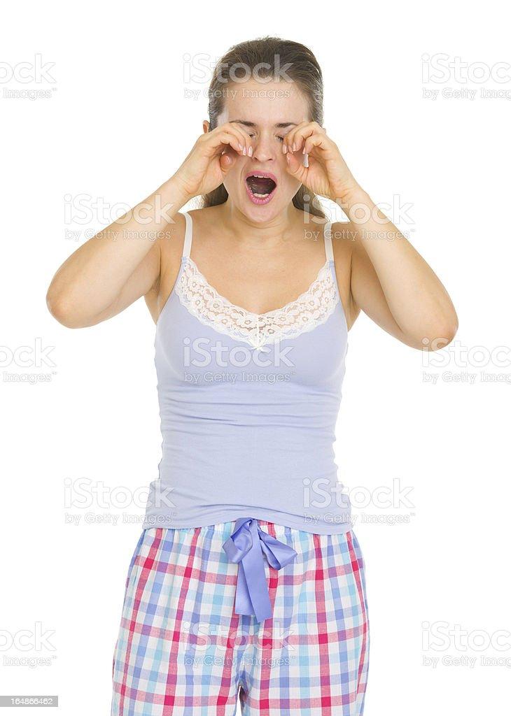 Young woman in pajamas rubbing eyes royalty-free stock photo