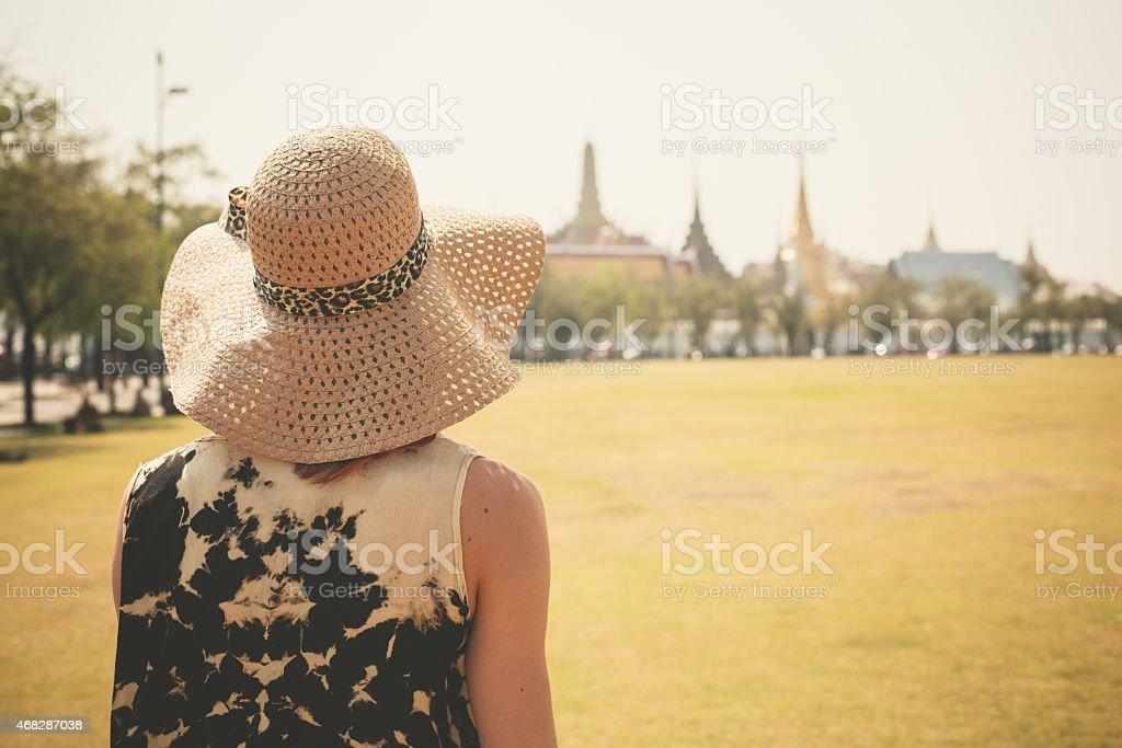 Young woman in park by palace stock photo