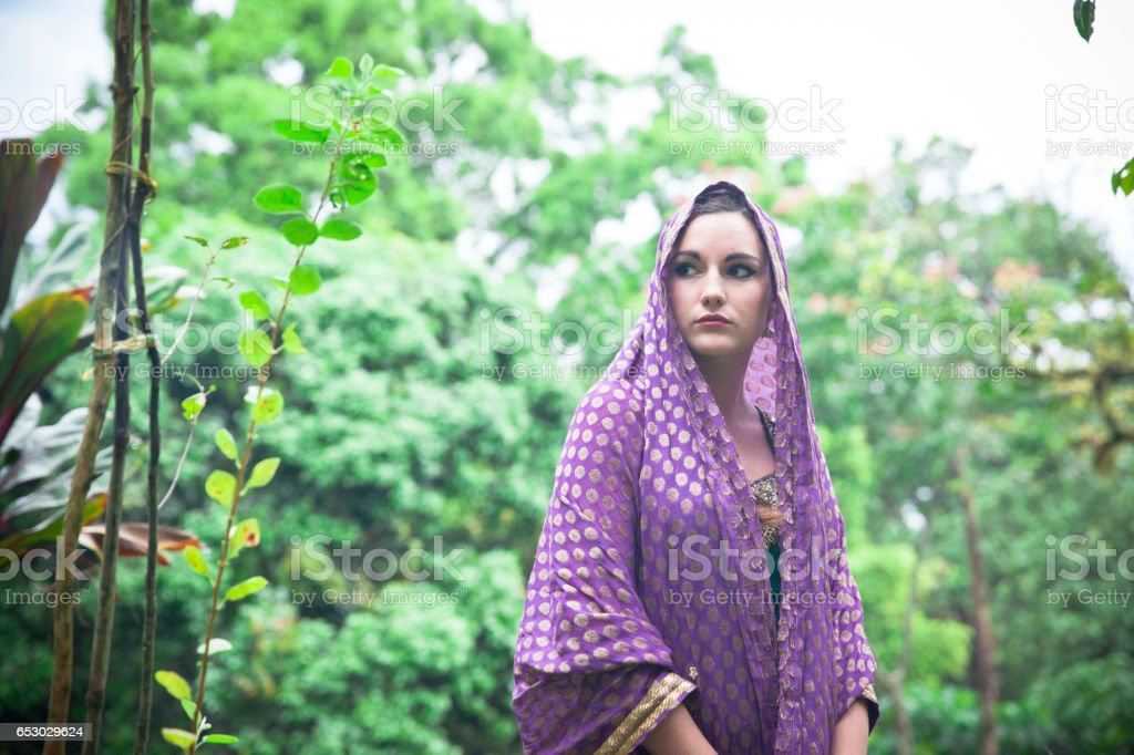Young woman in park in India stock photo