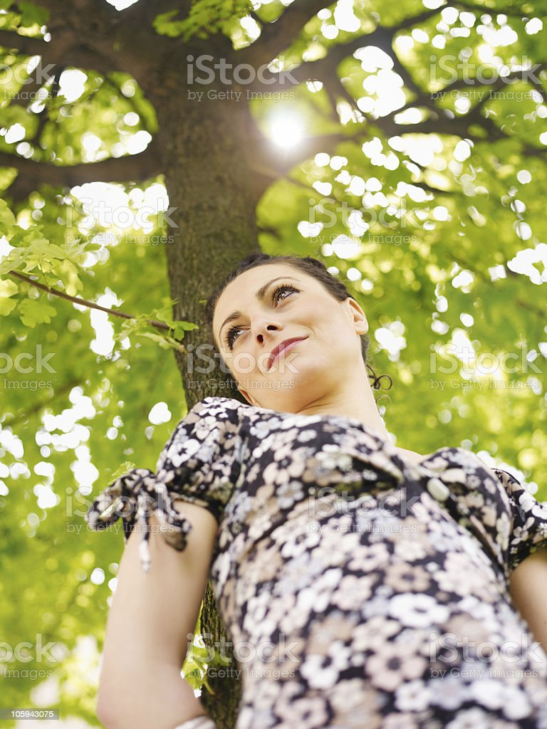young woman in park, smiling royalty-free stock photo