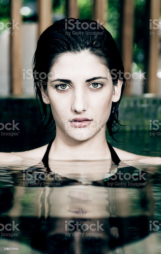 Young Woman in Pool, Portrait stock photo