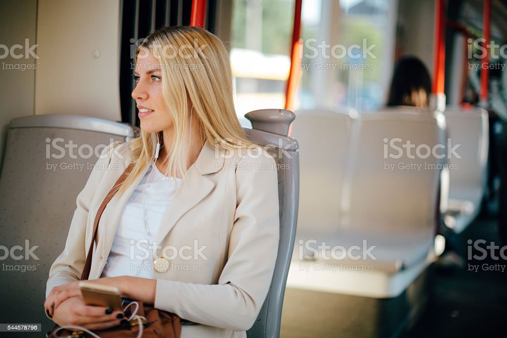 Young Woman In Public Transportation. stock photo