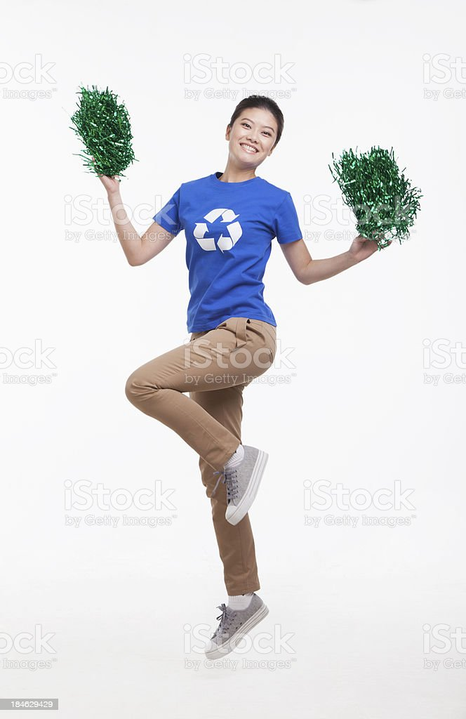 Young woman in recycling t-shirt cheering with pompoms royalty-free stock photo