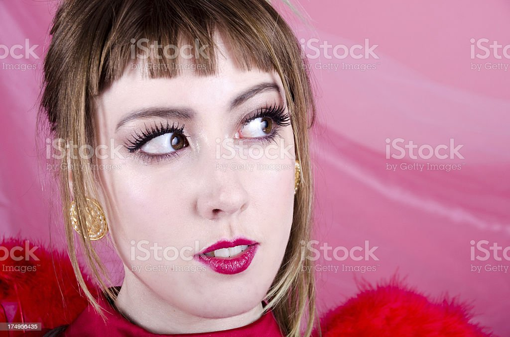 Young woman in red wings looking to side royalty-free stock photo