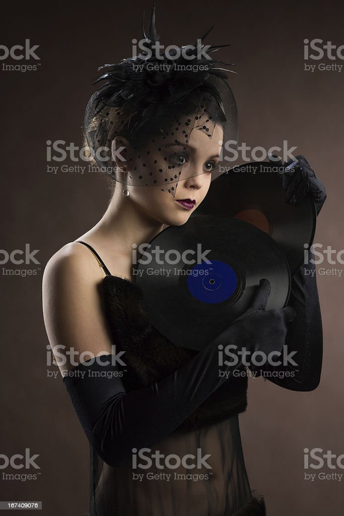 Young woman in retro style with vinyl plate royalty-free stock photo