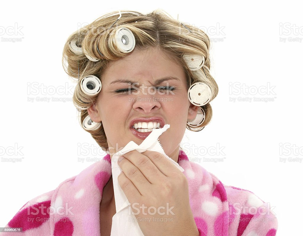Young Woman in Rollers and Robe Sneezing royalty-free stock photo