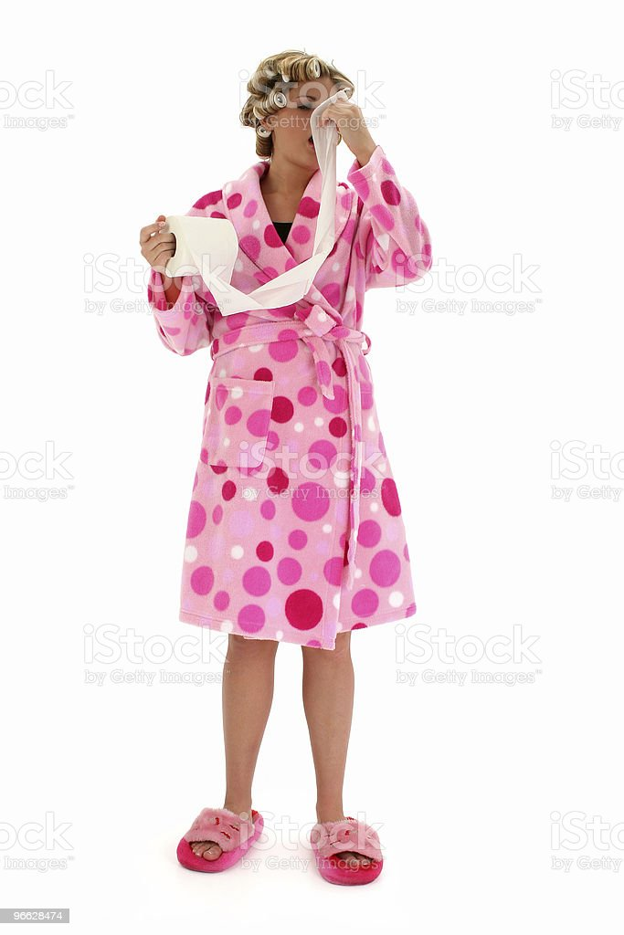 Young Woman in Rollers Blowing Her Nose royalty-free stock photo
