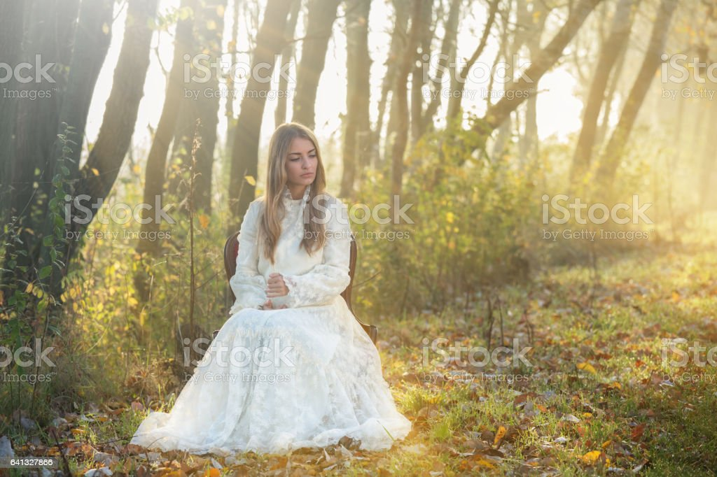 Young woman in romantic clothes stock photo