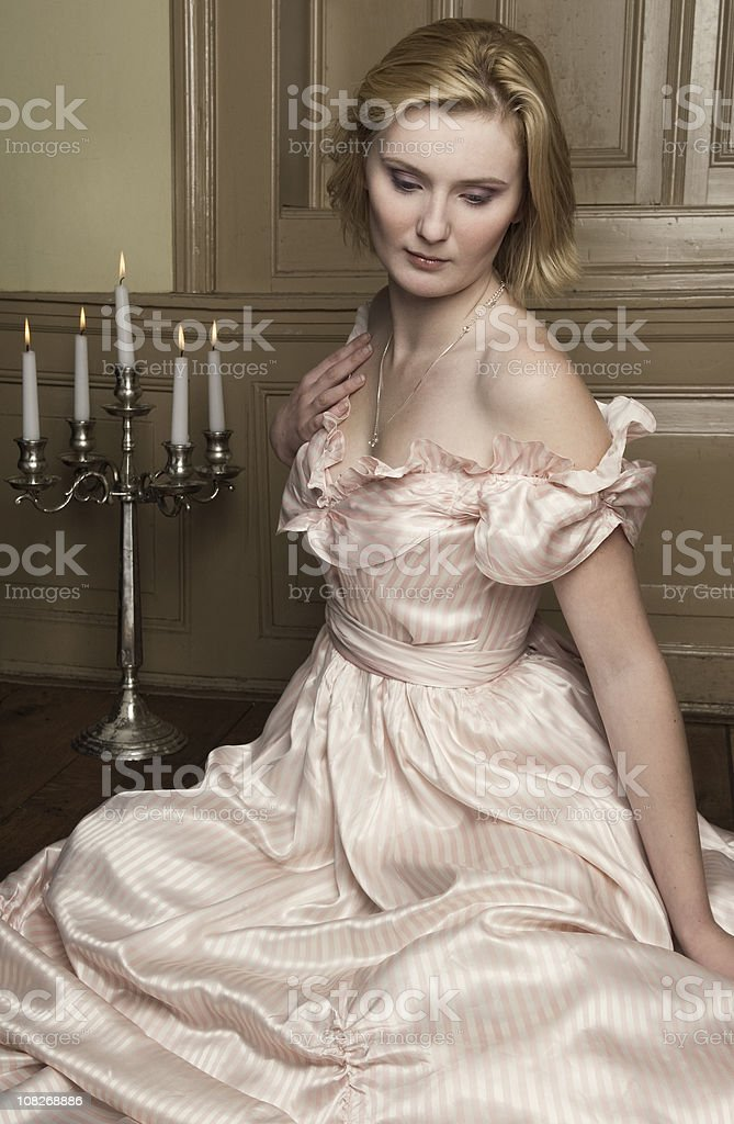 Young woman in romantic renaissance dress stock photo