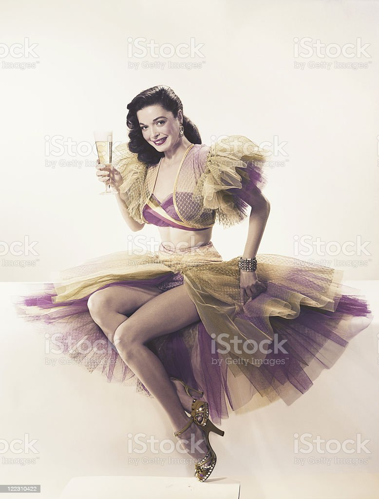 Young woman in ruffled dress holding beer glass, portrait stock photo